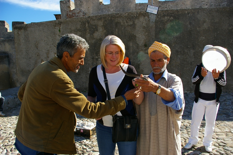 Dona with a Snake Charmer