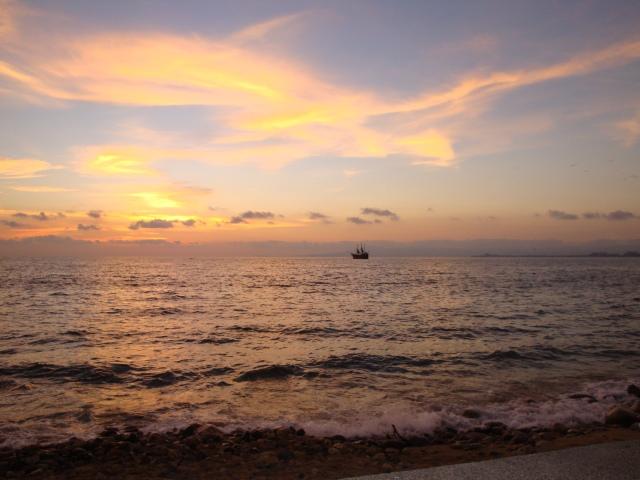 Ship Sailing into the Sunset in Puerto Vallarta
