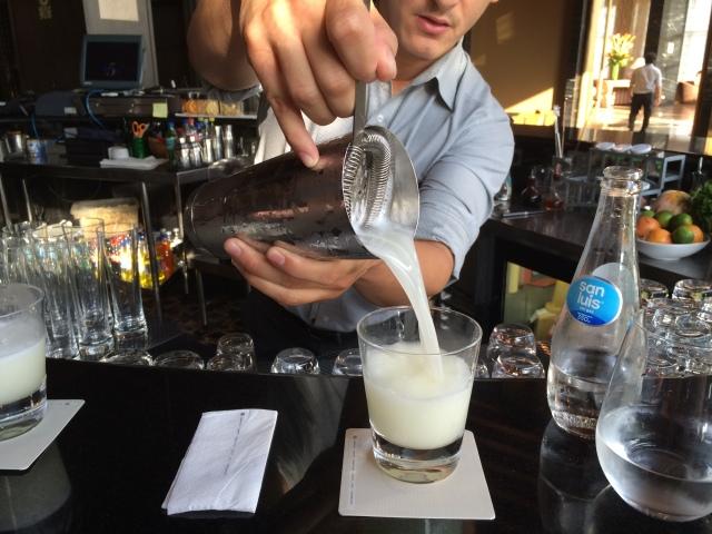 Pouring a Pisco Sour