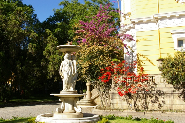Vibrant Flowers and Fountain at the Palacio Portales